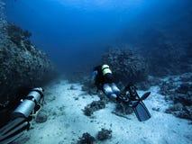 Scuba diver descending to the bottom royalty free stock photos