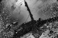 Scuba diver diving Ship Wreck in maldives indian ocean. Scuba diver dsilhouette iving on Ship Wreck underwater in maldives stock photography