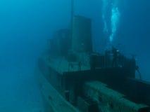 A Scuba Diver Explores a Wreck Royalty Free Stock Photo