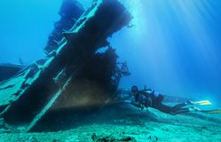 Scuba diver is exploring s sunken wreck in the aegean sea royalty free stock photos