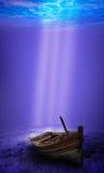 Scuba diver exploring a sunken underwater shipwreck Royalty Free Stock Photography