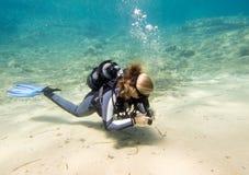 Scuba Diver. Female scuba diver during a dive royalty free stock images