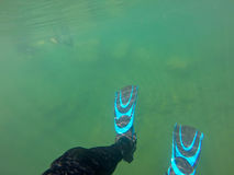 Scuba diver fins and legs underwater Royalty Free Stock Photos
