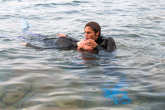 Diver rescue. Scuba diver giving CPR to a casualty Royalty Free Stock Photography