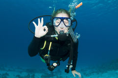 Scuba diver makes OK sign Stock Photo