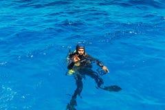Scuba diver makes the ok sign royalty free stock photo