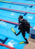 Scuba diver man training in a swimming pool stock photo