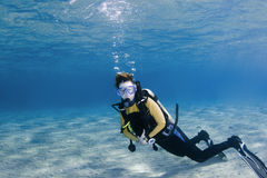 Scuba diver over white sand Stock Photo