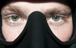 Scuba diver's eyes in mask. Close up of a mask underwater with eyes Royalty Free Stock Photo