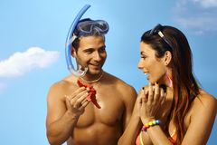 Scuba diver showing starfish to girlfriend royalty free stock photos