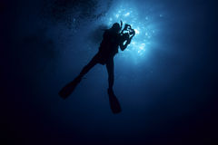 Scuba Diver Silhouette with Video Cam Stock Photography