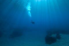 Scuba diver and sunrays Stock Photo