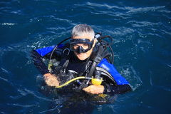 Scuba Diver surfaces Royalty Free Stock Photo
