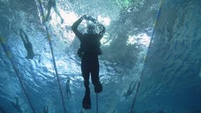 Scuba diver swimming in deep pool underwater view. Diving course in deep pool. Scuba diver swimming in deep pool underwater view. Scuba diving on background stock video footage