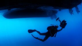 Scuba diver under ship Royalty Free Stock Photography