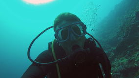Scuba Diver underwater. Male scuba diver swimming underwater.Scuba Diver in tropical sea.tropical underwater world.Diving and snorkeling in the tropical sea stock footage