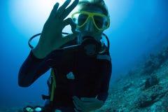 Scuba Diver. Underwater portrait of scuba diver showing ok signal royalty free stock images