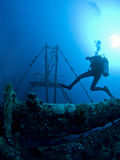 Scuba diver at underwater wreck. Scuba diver at sunken ship wreck underwater in the red sea, egypt Royalty Free Stock Photos