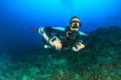 SCUBA Diver using sidemount tanks Royalty Free Stock Images