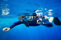 Scuba diver woman in  blue water. Royalty Free Stock Photography