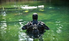 Scuba diver worker is over viewing underwater archaeology works. Lake or river underwater archaeological survey works in progress with supervisor in diving stock images
