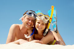 Scuba divers. Portrait of cheerful couple in aqualungs looking at camera with smiles Stock Image