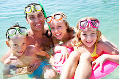 Scuba divers. Portrait of cheerful family in aqualungs looking at camera with smiles Stock Photos