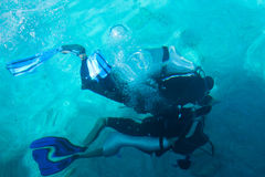 Scuba Divers. Two scuba divers underwater in tropical seas, shot from above water Royalty Free Stock Photography