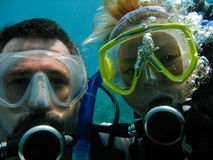 Scuba divers. Portrait of a man and woman scuba diving Stock Image