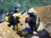Scuba Divers. Two men prepare for diving stock photography