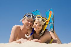 Scuba divers. Portrait of cheerful couple in aqualungs looking at camera with smiles Royalty Free Stock Photo