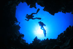 Scuba Divers above Cavern Stock Photos