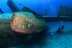 SCUBA divers around an aircraft wreck Royalty Free Stock Photos