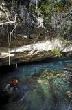 Scuba divers in cenote Stock Photography