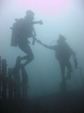 Scuba divers diving sabang wrecks puerta galera Royalty Free Stock Photos