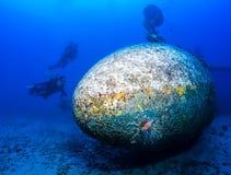 SCUBA divers explore the wreck of an aircraft Stock Photography