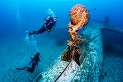 SCUBA divers explore the wreck of an aircraft Royalty Free Stock Photos