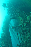 Scuba divers exploring a ship wreck in red sea royalty free stock images