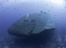 Scuba divers exploring a shipwreck Royalty Free Stock Photos