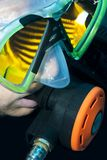 Scuba divers face, mask and fish reflection Royalty Free Stock Image