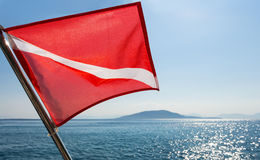 Scuba divers flag waving on a boat Royalty Free Stock Image