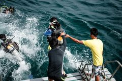Scuba divers are going jump to the sea at Chonburi, Thailand. stock photos