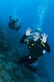 Scuba divers having fun on a dive Stock Photo