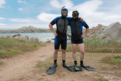 Scuba divers on island. Two scuba divers on island Stock Photography
