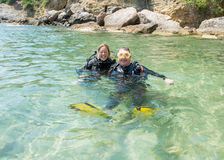 Scuba Divers. Male and female scuba divers have fun during a recue diver course Stock Images