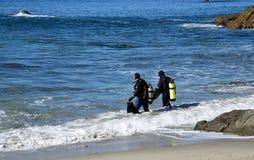 SCUBA divers at Moss Street Cove, Laguna Beach, California stock images