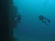 Scuba Divers and a ship wreck Stock Photos