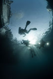 Scuba divers in silhouette Royalty Free Stock Images
