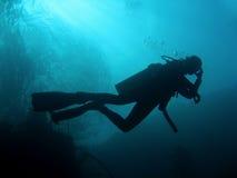 Scuba Divers silhouette sipadan borneo Stock Images
