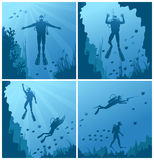 Scuba divers under water Stock Photo